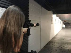girl shooting rifle